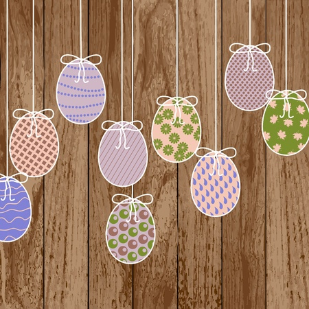 A color Easter eggs on wooden texture