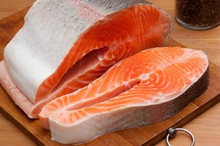 Raw salmon on wood table