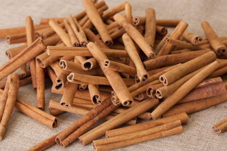 cannelle: Cinnamon on a sacking Stock Photo