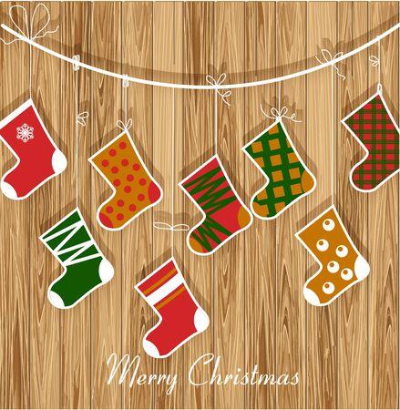botas de navidad: Tarjeta de Navidad con las botas de regalos en el fondo de madera