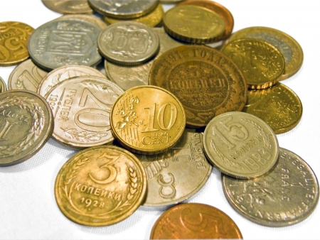 coins of different denominations, different countries and times  Фото со стока