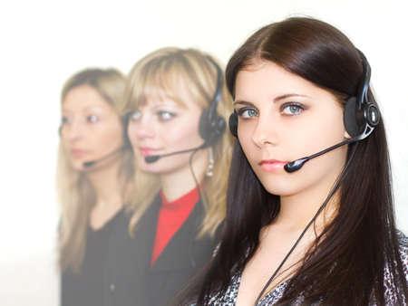 beautiful young girls telephone operators in headphones i Stock Photo - 9315033