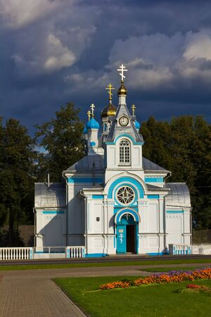 gleaming: white orthodox church with gleaming crosses on a dark stormy sky