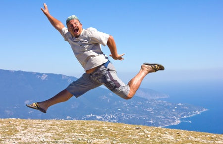 over the sea: happy man jumping over the Crimean Mountains and the Black Sea