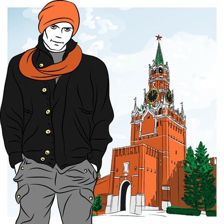 red square moscow: stylish guy on the background of the Spasskaya tower of Moscow Kremlin, Russia, View from Red Square