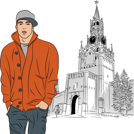 stylish guy on the background of the Spasskaya tower of Moscow Kremlin, Russia, View from Red Square