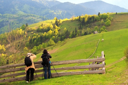 carpathian mountains: Photographers take pictures of spring rural landscape in the Carpathian mountains