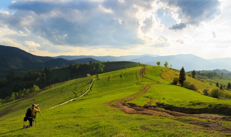 carpathian mountains: Photographers take pictures of spring rural landscape in the Mizhhiria, Carpathian mountains Stock Photo