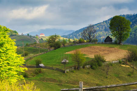 carpathian mountains: Spring morning rural landscape with cute farm outside the fence in the Mizhhiria, Carpathian mountains