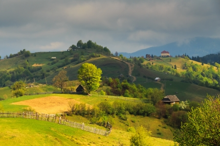 carpathian mountains: Spring gloomy overcast morning rural landscape in the Mizhhiria, Carpathian mountains.  Stock Photo