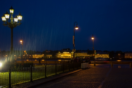 granite park: Rainy night on the Neva River in the evening light in St. Petersburg, Russia