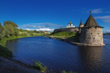 Stone tower and Pskov Kremlin fortress wall at the confluence of two rivers, Russia photo