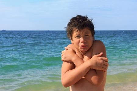 boy swim: boy of twelve freezes on the sea beach Stock Photo