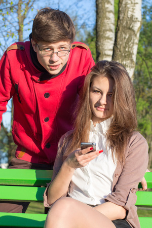 Young fashion elegant stylish couple posing in a European city park  Hipster cute girl with handsome man having fun outdoor