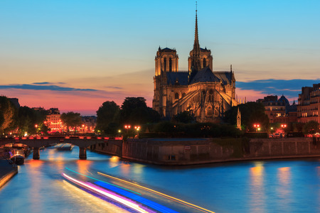 The southern facade of Cathedral of Notre Dame de Paris at sunset photo