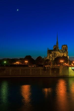 notre dame de paris: The southern facade of Cathedral of Notre Dame de Paris at sunset