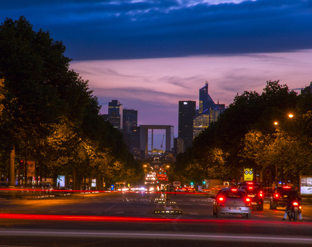 elysees: Champs Elysees and the Grande Arche La Defense at night, the view from the Arc de Triomphe, Paris, France