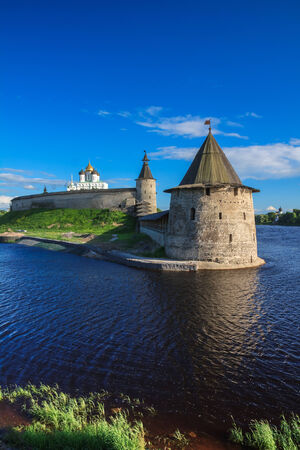 loopholes: Stone tower and Pskov Kremlin fortress wall at the confluence of two rivers, Russia