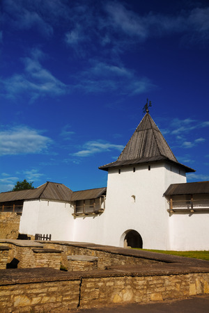 loopholes: White stone tower and a fortress wall of Pskov Kremlin, Russia