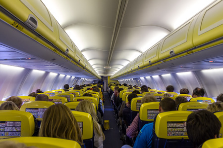 scheduled: VILNIUS, LITHUANIA - MAY 2  Passenger compartment of the aircraft company Ryanair  Ryanair is one of the largest low-cost European airline by scheduled passengers carried