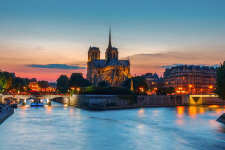 notre: The southern facade of Cathedral of Notre Dame de Paris at sunset