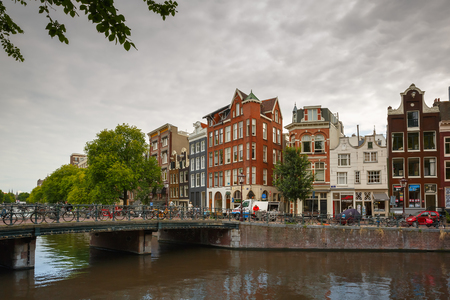 Amsterdam, Netherlands - July 30,2014  City view of Amsterdam Singel canal and typical houses and bicycles  Canal ring area placed on the UNESCO World Heritage List