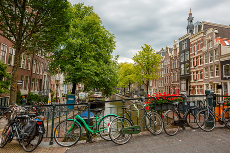westerkerk: City view of Amsterdam canals and typical houses, boats and bicycles, Holland, Netherlands   Stock Photo