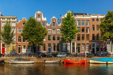 City view of Amsterdam canals and typical houses, boats and bicycles, Holland, Netherlands   photo