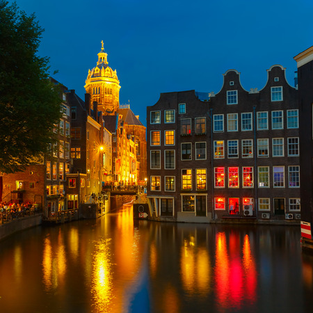 Night city view of Amsterdam canal, bridge and typical houses, Holland, Netherlands  Long exposure   photo