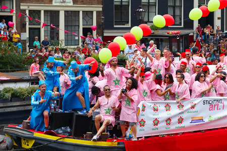 canal parade: Amsterdam, Netherlands - August 2, 2014: Moroccan boat at the famous Canal Parade of the Amsterdam Gay Pride 2014. Every year the parade is visited by more than 400 000 people