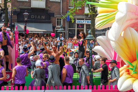 canal parade: Amsterdam, Netherlands - August 2, 2014: Conchita Wurst at the famous Canal Parade of the Amsterdam Gay Pride 2014. Every year the parade is visited by more than 400000 people.