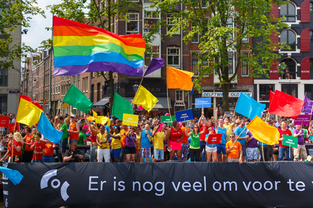 nederland: Amsterdam, Netherlands - August 2, 2014: COC Nederland boat at the famous Canal Parade of the Amsterdam Gay Pride 2014. Every year the parade is visited by more than 400,000 people