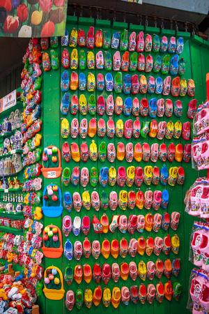 Amsterdam, Netherlands - July 30,2014: Souvenir shop in Amsterdam. Wooden shoes clogs, windmills and tulips - the most popular souvenirs and traditional symbol of Holland.
