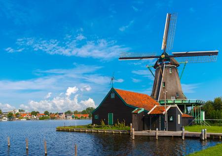 holland landscape: Picturesque rural landscape with windmills in Zaanse Schans close to river, Holland, Netherlands