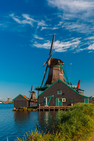 petrol powered: Picturesque rural landscape with windmills in Zaanse Schans close to river, Holland, Netherlands