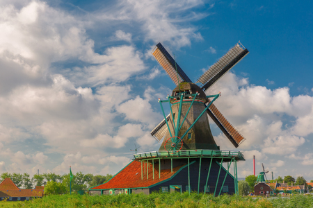 Picturesque rural landscape with windmills in Zaanse Schans close to river, Holland, Netherlands photo
