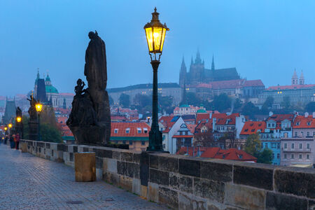 Charles Bridge and Prague Castle in Prague (Czech Republic) at night lighting. photo