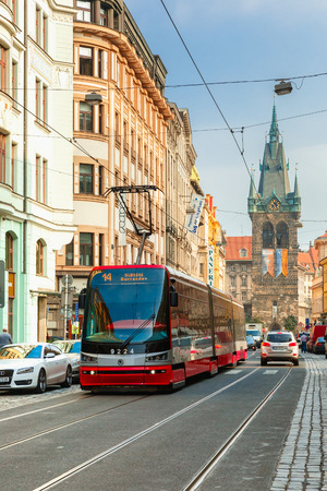 electric avenue: Prague, Czech republic - October 2, 2014: One of the symbol of Prague, red modern tram near Jindrisska Tower in Old Town.