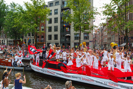 canal parade: Amsterdam, Netherlands - August 2, 2014: Participants at the famous Canal Parade of the Amsterdam Gay Pride 2014. Every year the parade is visited by more than 400000 people. Editorial