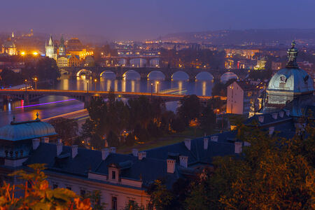Aerial view over Old Town and bridges over the Vltava River in Prague at night, Czech Republic photo