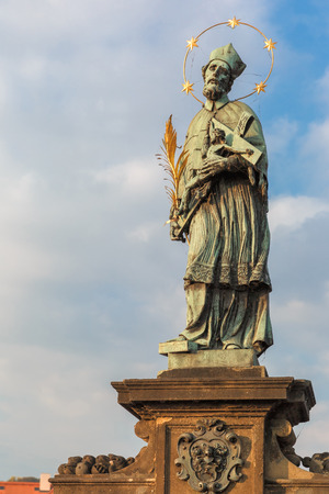 patron: Statue of St. John of Nepomuk, the patron saint of Prague, on the Charles Bridge in Prague, Czech Republic