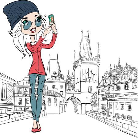 Cute beautiful fashionable girl makes selfie on the Charles Bridge in Prague Vector