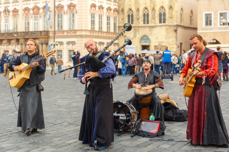 bagpipes: Prague, Czech Republic - September 30, 2014: Street musicians (Buskers) with guitar, bagpipes and drum on the Old Town Square.