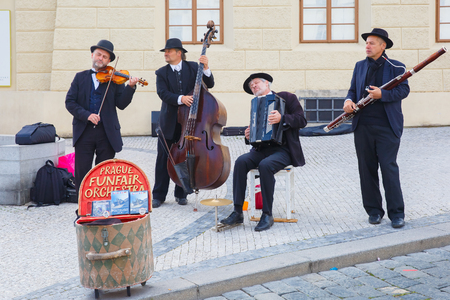play popular: Prague, Czech Republic - October 6, 2014: Street musicians (Buskers) with violin, clarinet, viola, accordion of the Funfair orchestra on the Old Town.
