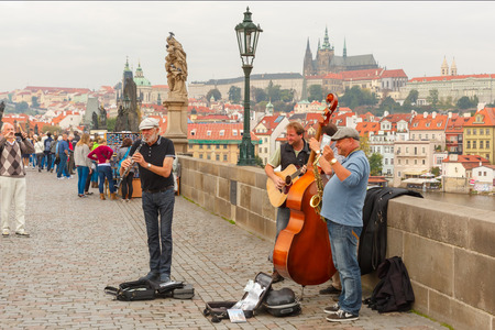 prague: Street musicians (Buskers) on the Charles Bridge in Prague, Czech Republic