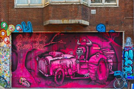 vandalize: Amsterdam, Netherlands - August 1, 2014: Urban graffiti on the street Spui Editorial