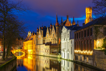 Scenic cityscape with a medieval tower Belfort and the Green canal (Groenerei)  at sunset in Bruges, Belgium photo