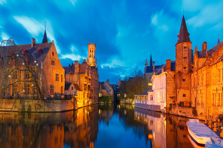belfort: Scenic cityscape with a medieval fairytale town and tower Belfort from the quay Rosary (Rozenhoedkaai) at sunset in Bruges, Belgium