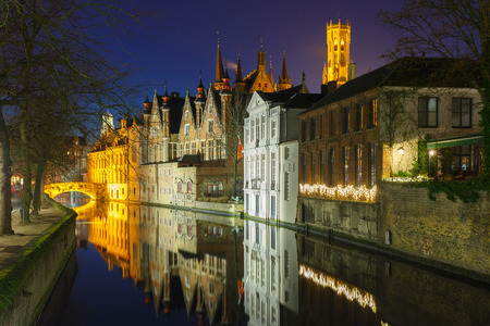 belfort: Scenic night cityscape with a medieval tower Belfort and the Green canal (Groenerei) in Bruges, Belgium