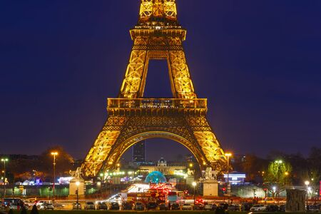 Paris, France - January 1, 2015: Cityscape with shimmering Eiffel tower Light Performance Show at night in the New Year. Eiffel Tower - a symbol of Paris, the most visited and photographed landmark.